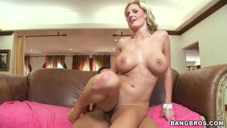 Spicy blond Zoe Holloway with massive tits needs a massive lovestick to ride passionately